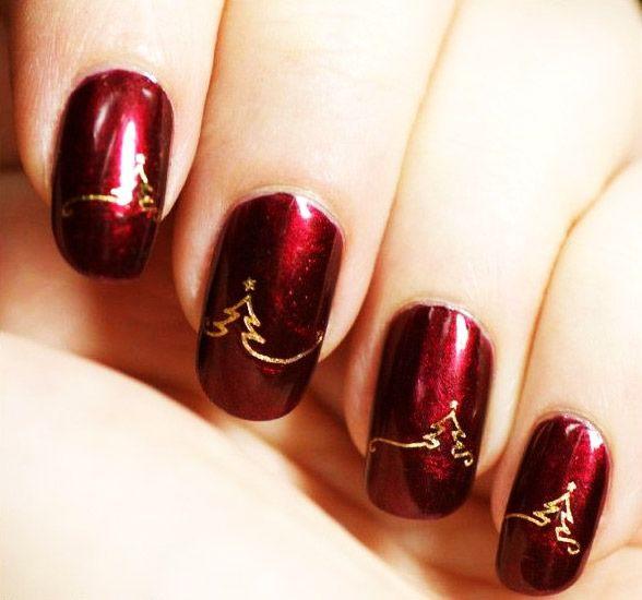 Vánoční stromky zlata na červené nehty
